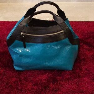 Kate Spade teal patent leather hand bag.
